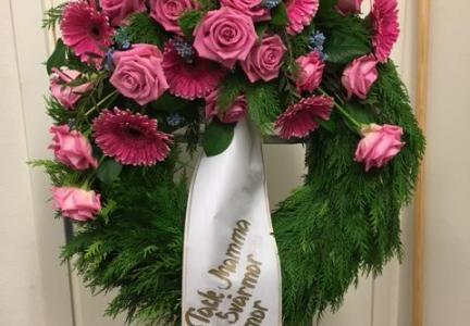 Krans med rosa ros