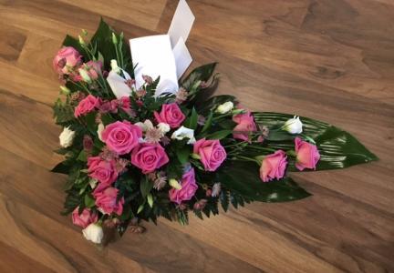 Sorgbukett med rosa ros